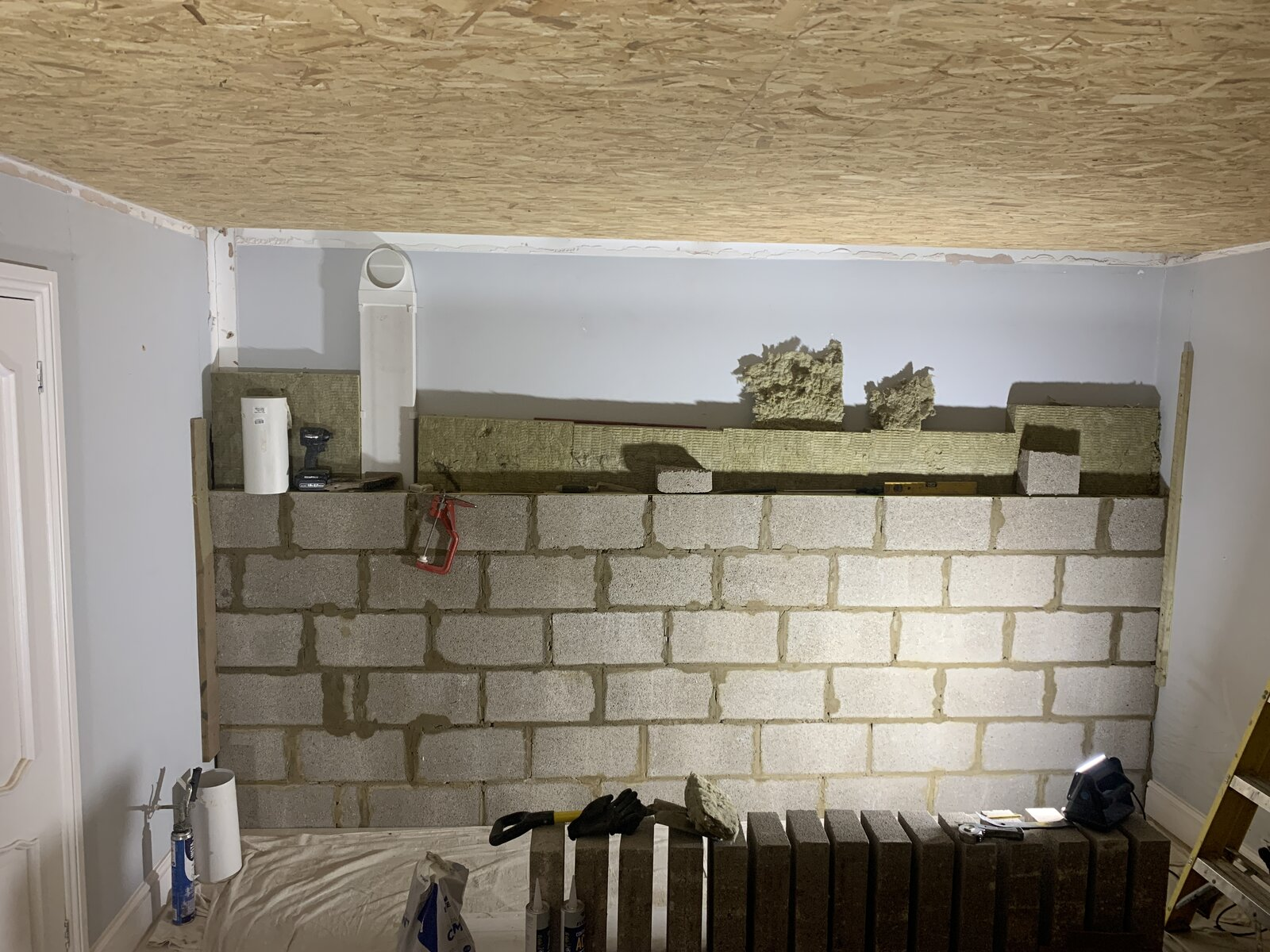 New blockwork wall and vent duct