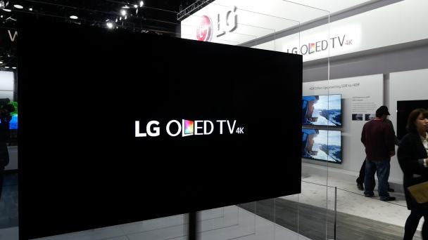 What is the difference between a QLED and OLED TV?